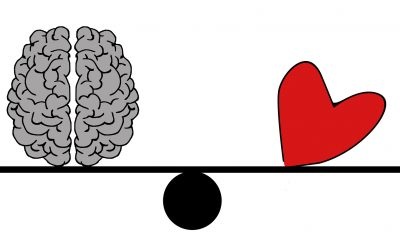 A drawing illustrates the heart and brain as a balancing act
