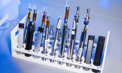 An assortment of vape devices and oils