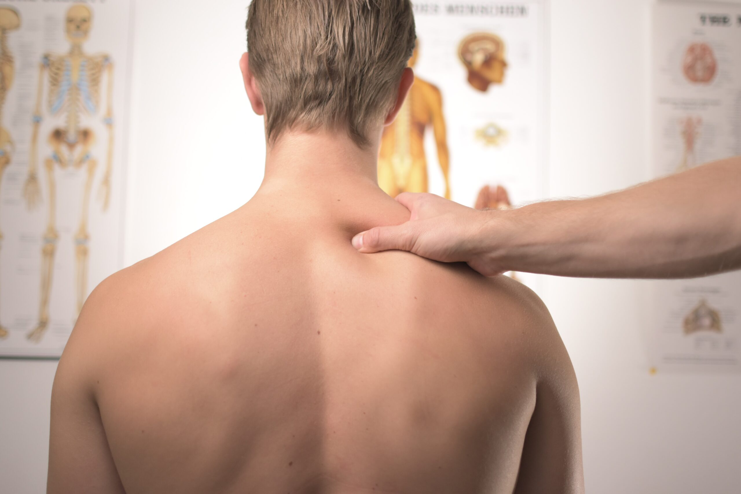 Man receives shoulder massage in a physician's clinic