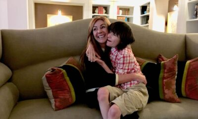 Mother and son hug on the couch at home