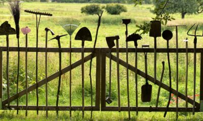 A close up of gardening tools on a fence