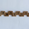 The word 'dermatology' spelled out using scrabble letters
