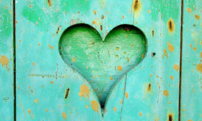 A heart carved on wooden fance