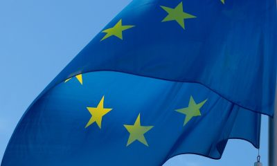 A European flag against a blue background