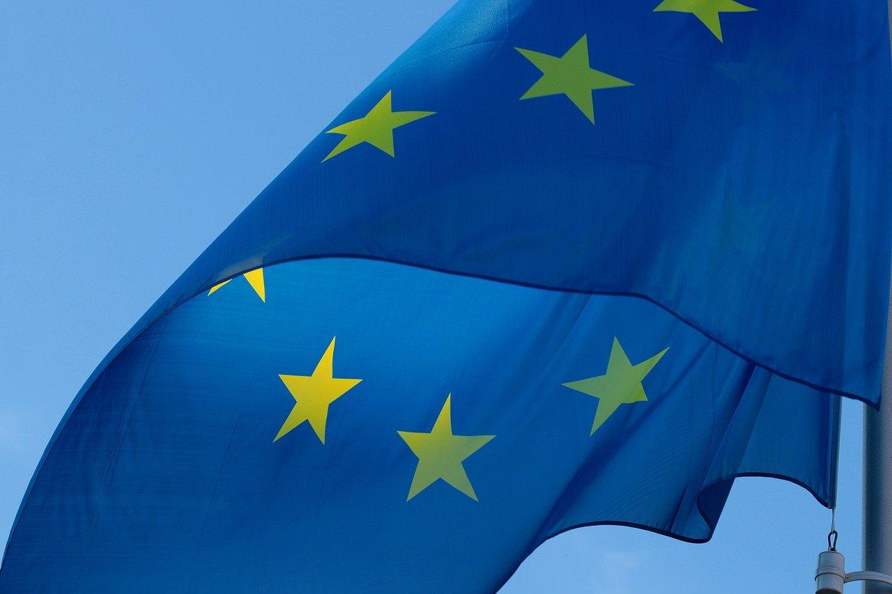 A European flag against a blue background