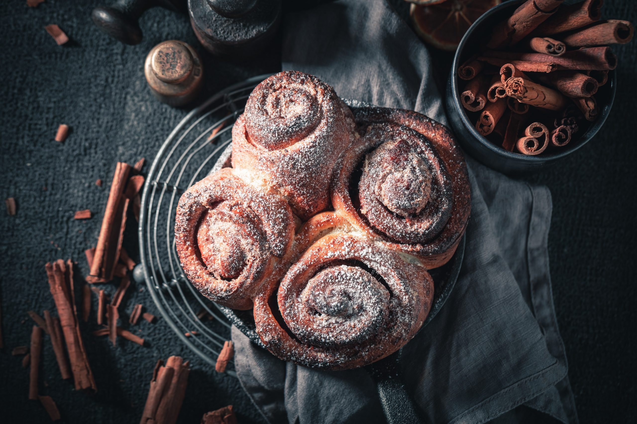 Cinnamon rolls on a plate, ready to be served.