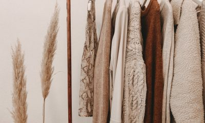 A row of hemp fashion hanging on a rail in beige and brown tones