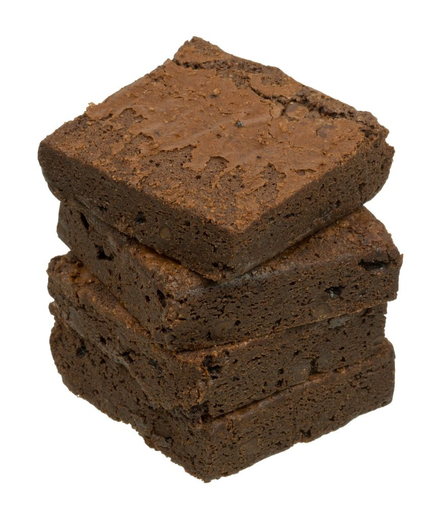 A stack of chocolate brownies on a white background.