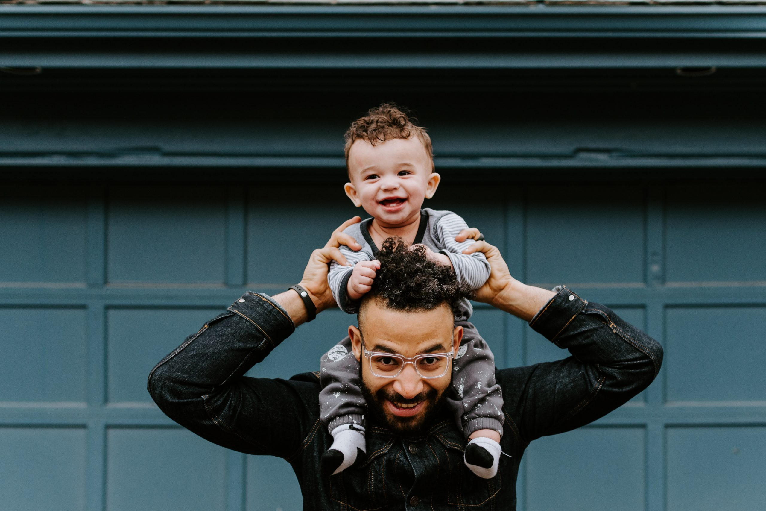 Man with child on shoulders