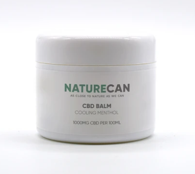 A father's day present of a white tub of CBD muscle balm with a green and Naturecan logo