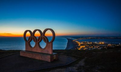 Olympic statue over water